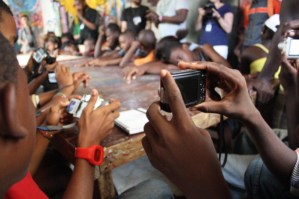 Haitian youth learn how to use point-and-shoot digital cameras during Jouk Li Jou Kan Foto 10-day photojournalism camp run by nonprofit Zanmi Lakay in Jacmel, Haiti,July 2012.