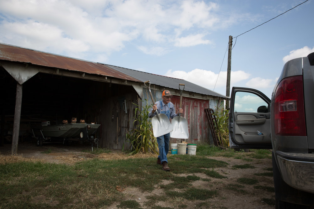 """""""Double shovel, baby,"""" Carl laughs as he grabs shovels for himself and son Mike.After retiring from the service station business in 1995, Carl began working on his son's 350-acre farm in Barnett, Mo.The two of them tend the farm together daily without any outside assistance."""