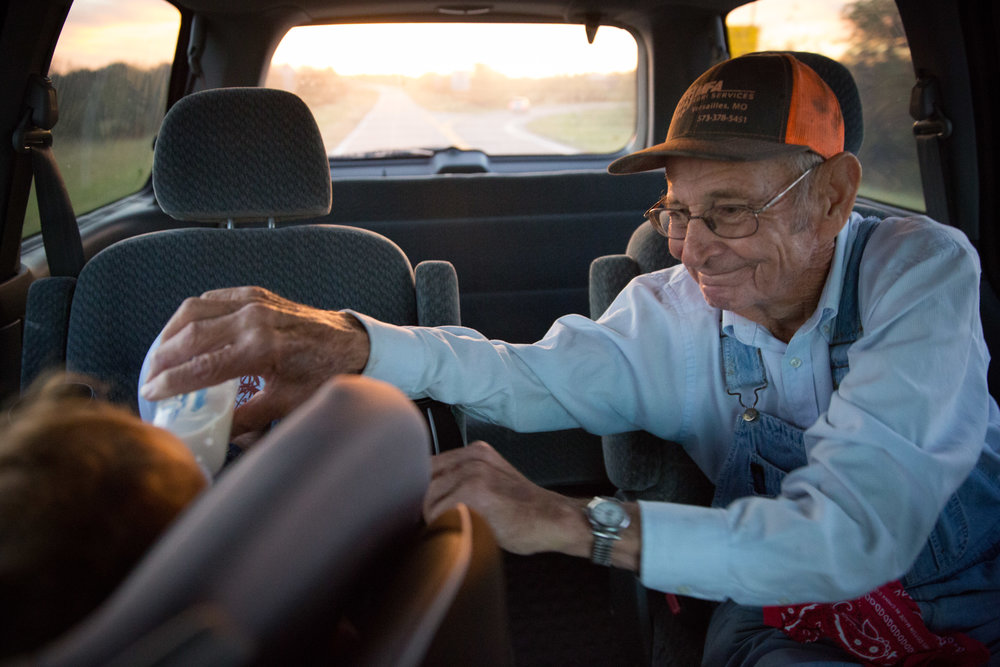 """Some days Carl and his son Mike drive great-grandson Mason to daycare. The family calls this """"The Grandpa Express."""""""