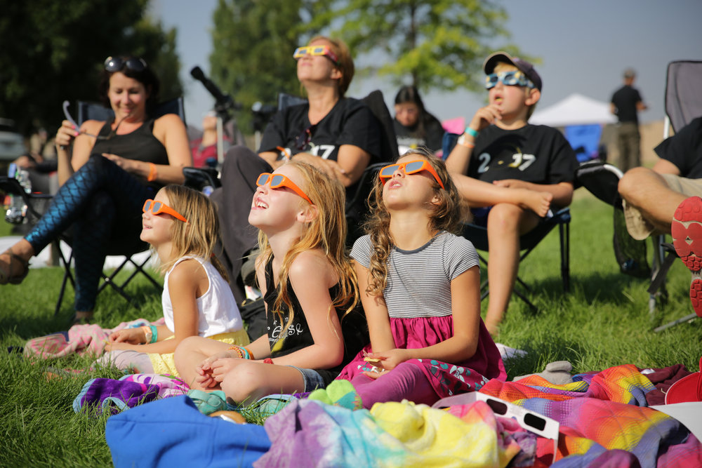 A family watches the total solar eclipse at Solarfest in Madras, Ore. on Monday Aug. 21, 2017. The last time the contiguous U.S. saw a total eclipse was in 1979.