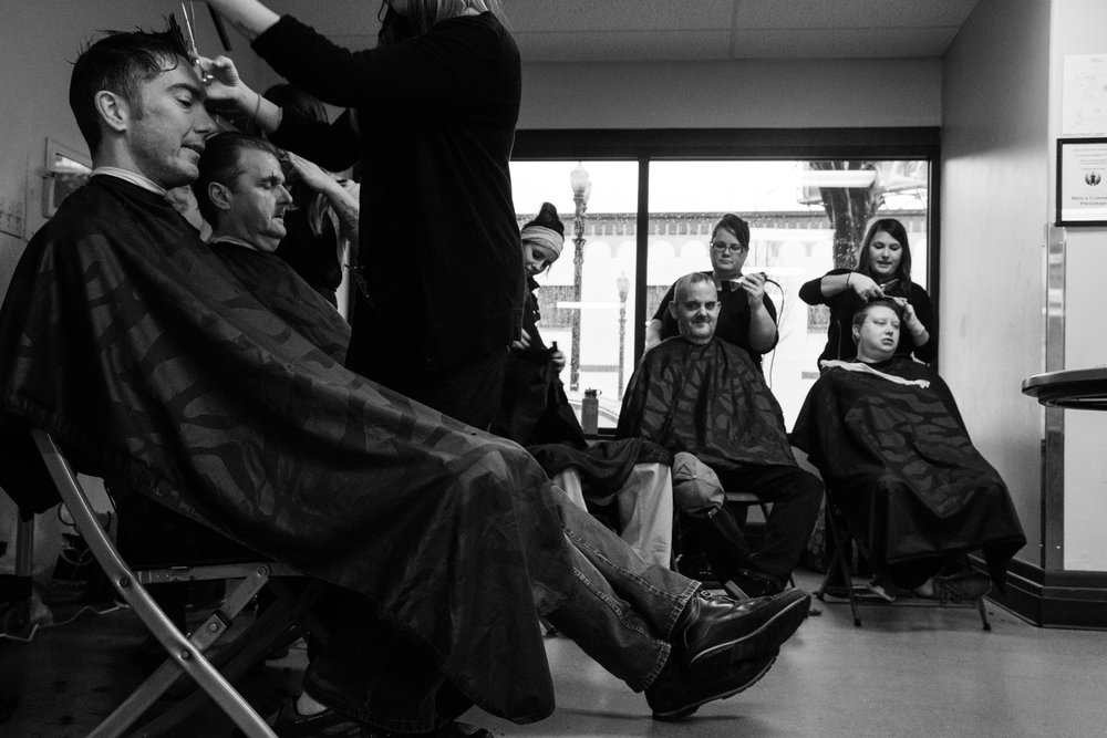 Stylists from Identity Hair & Spa cut and shave hair at Portland Rescue Mission in Portland, Ore., on Feb. 16, 2017. The salon partnered with Melody's Angels to provide a day of free makeovers, in an effort to boost people's confidence, especially for those seeking employment.