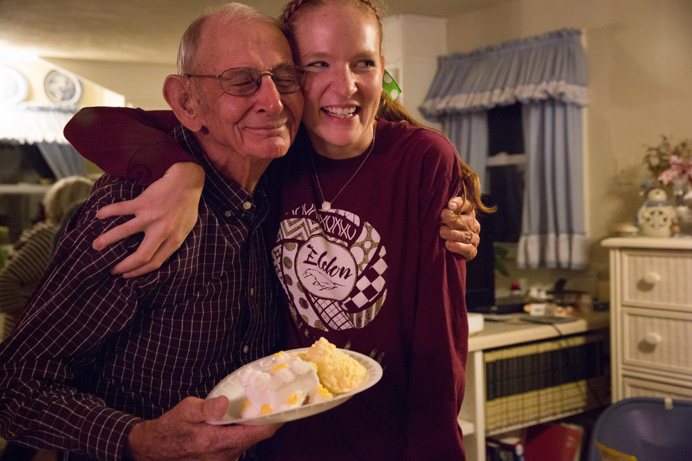 Carl hugs granddaughter Andrea on his 85th Birthday. He doesn't like to make a fuss, but agreed to let the family bring cake and ice cream to his house for an intimate celebration.