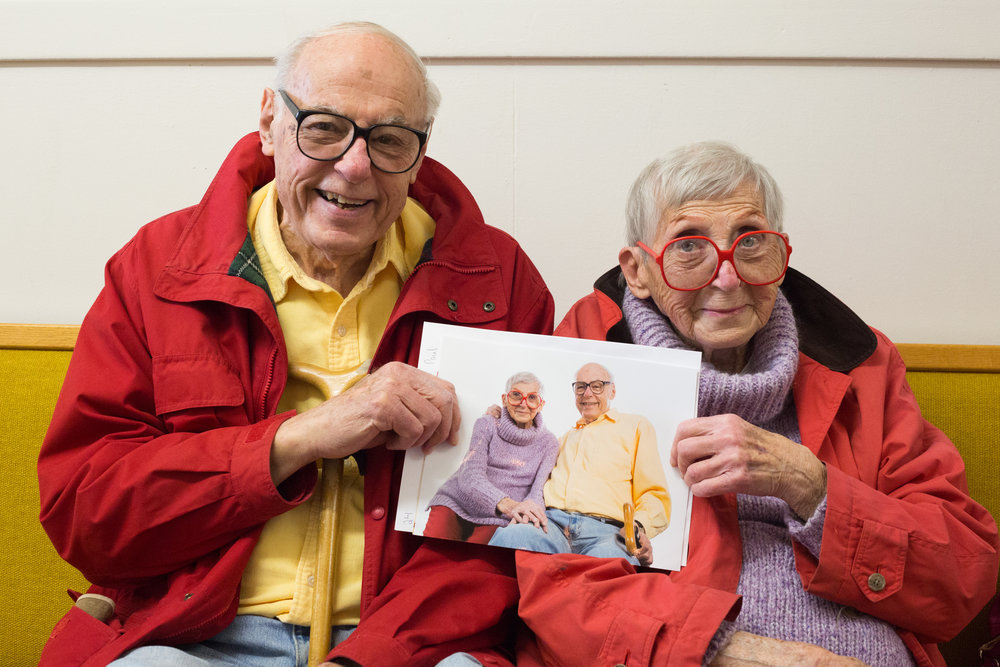 Verna and Paul show off their photograph made at a Help-Portrait event in Lincoln City, Ore., on Sunday, Dec. 3, 2017. Married in 1966, they've come to this event for eight years and put each portrait in a scrapbook that documents their relationship. Professional photographers volunteer their services at Help-Portrait events around the world, making free portraits for people in their communities.