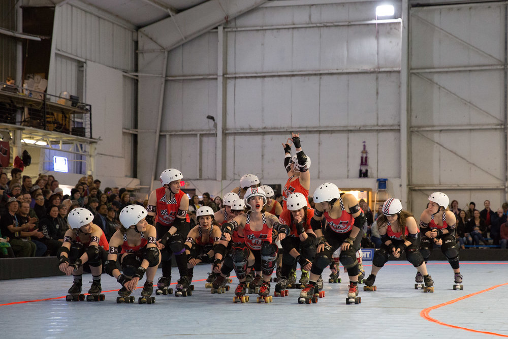 Fleur de Lethal waves to the crowd as she's introduced by the emcee on March 24, 2018. Lethal is one of two new players drafted by the Betties at the start of the 2018 season. Between playing and coaching, she has derby commitments six days a week.