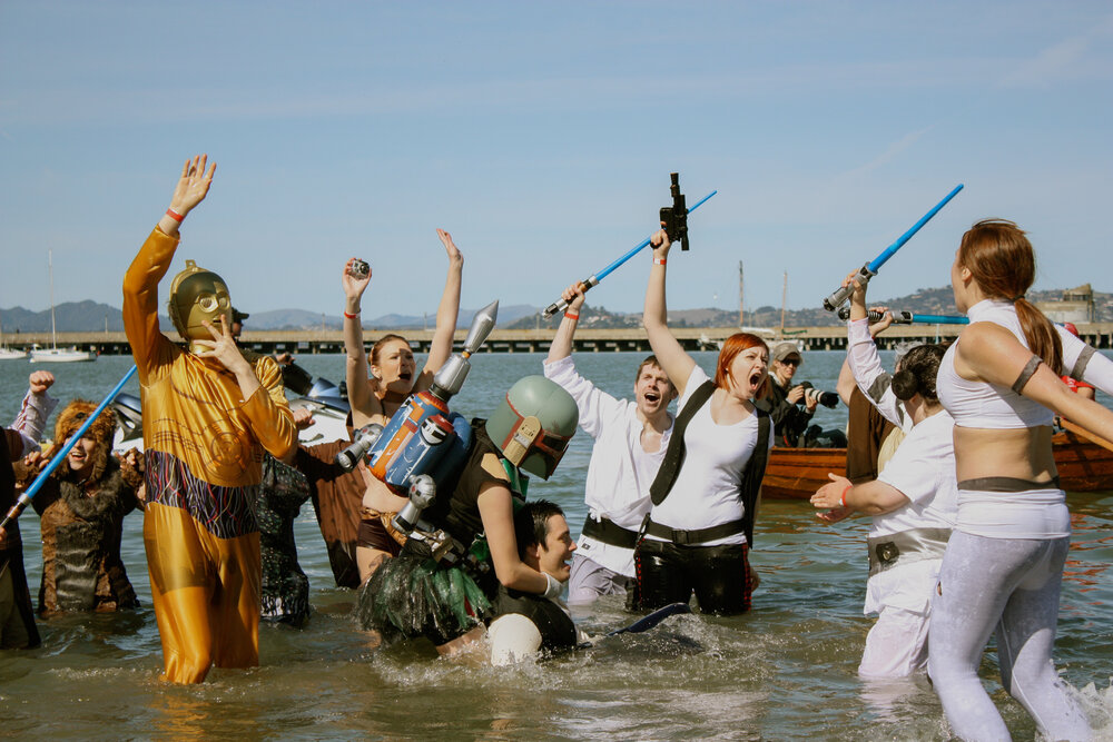 Team Star Wars lingers in the water during the Polar Plunge at Aquatic Park in San Francisco, Calif., Feb. 2012. At this annual event, costumed teams jump into the chilly bay water to raise money for the Special Olympics of Northern California.