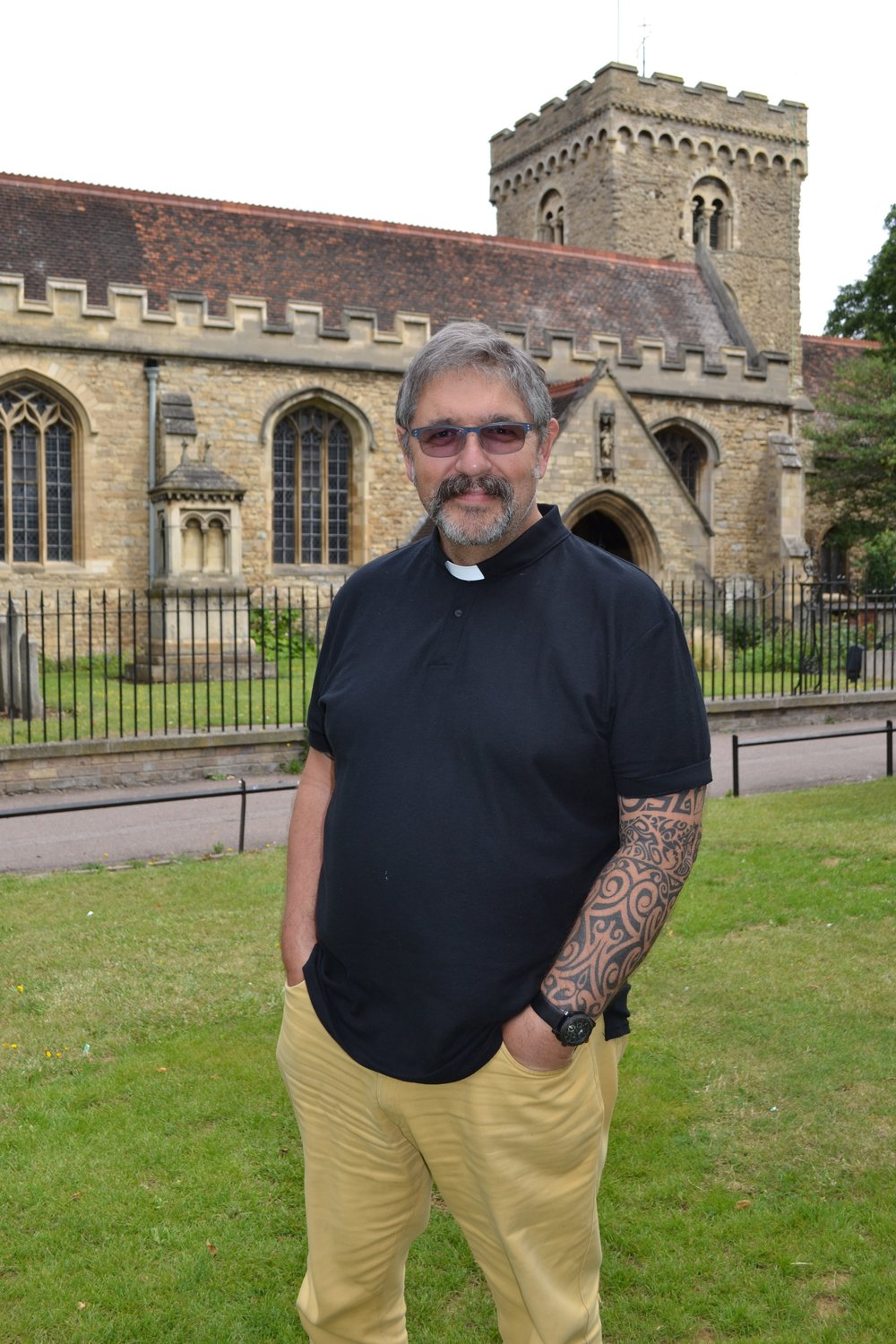 Revd Kelvin outside his church in Bedford