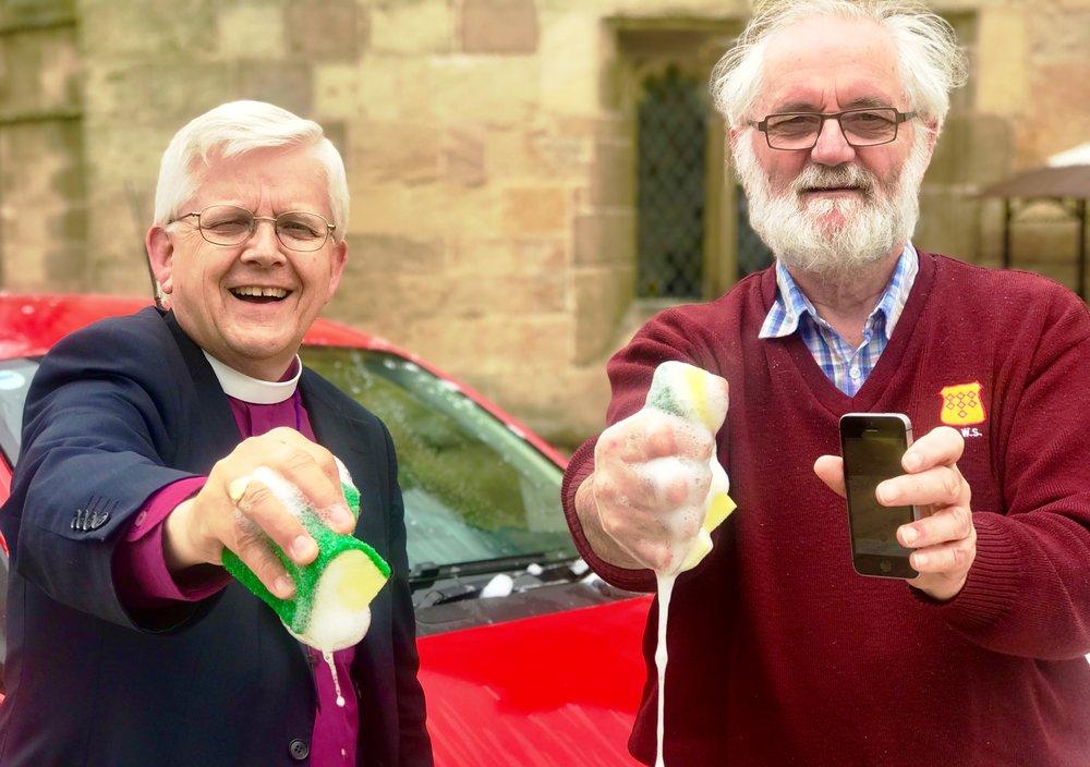 Bishop of Blackburn (L) and Rev Canon Ed Saville (R) promote the Safe Car Wash App