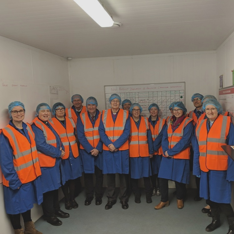 The group kitted out for a tour around the factory