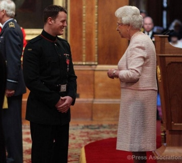 Michael Swain being awarded an MBE from Her Majesty the Queen.