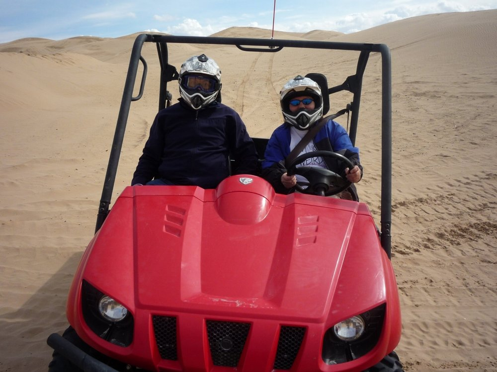 Roxanne behind the wheel on the sand dunes