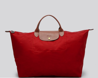 Longchamp  Le Pliage Nylon Weekender  - Perfect for a weekend trip, you'll have this bag forever! It is sturdy, easily cleaned, water proof, and holds a ton of stuff. It also folds up so small that you can throw it in another bag and use it later if you buy too much and need to get it home!