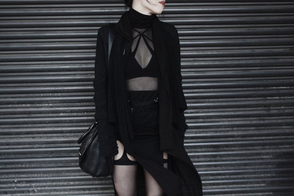 | Outerwear  Gareth Pugh Jacket, H&M Cardigan, eBay Mesh Top, Missguided Skirt  | Underwear  Agent Provocateur Robyn Bra,  Hopeless Lingerie Lucy Bralette ,  Charnos Suspender Tights   | Accessories   Givenchy Pandora Bag ,  Zana Bayne Snake Harness  (worn as belt)