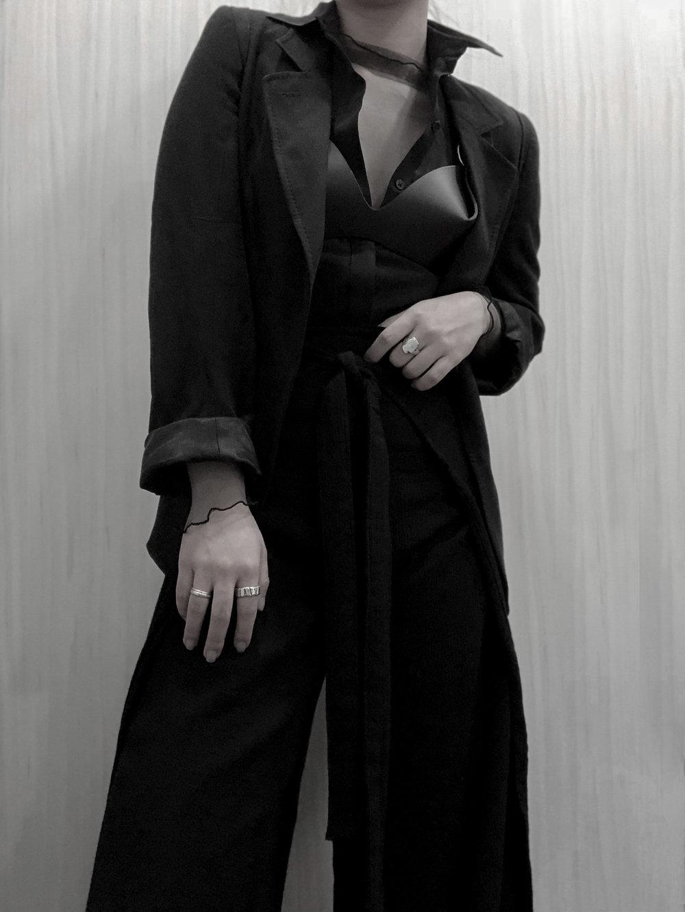 | Fleet Ilya   O-Ring Cross Back Bra   | Ann Demeulemeester  Blazer/Suede Jacket  | Calvin Klein  Shirt  | Sisters of the Black Moon   Rogalin Pants