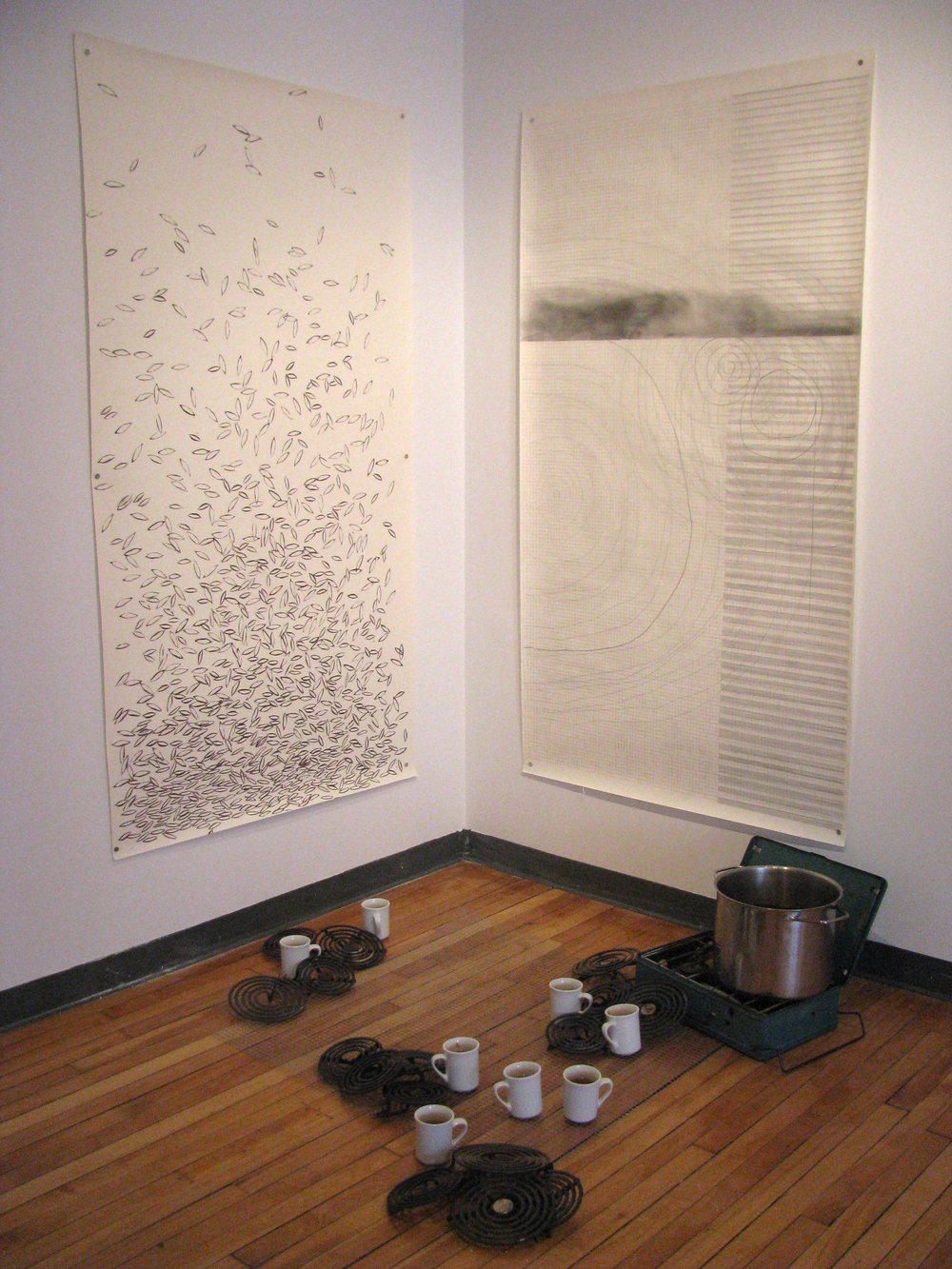 Suzanne Morrissette,  solve, for some  (installation shot),   2011, installation with ink and pencil on paper, cookstove, wire mesh, ceramic cups, labrador tea, stovetop elements.Photo by Lisa Myers.