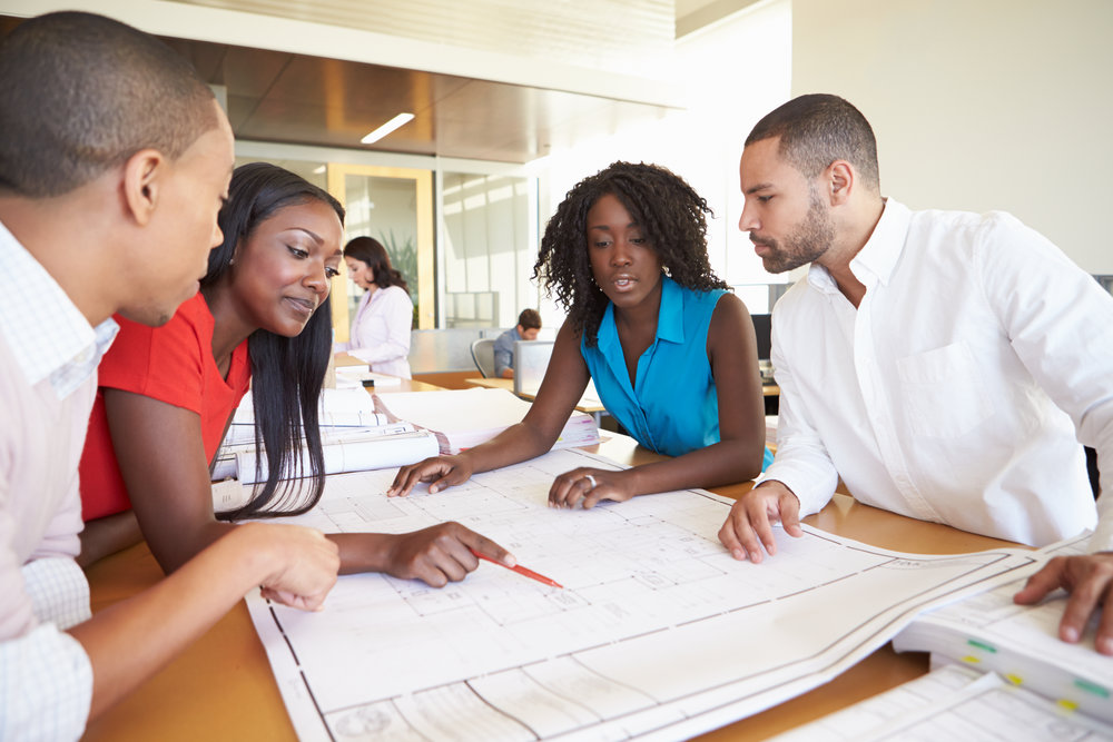 stock-photo-group-of-architects-discussing-plans-in-modern-office-174543044.jpg