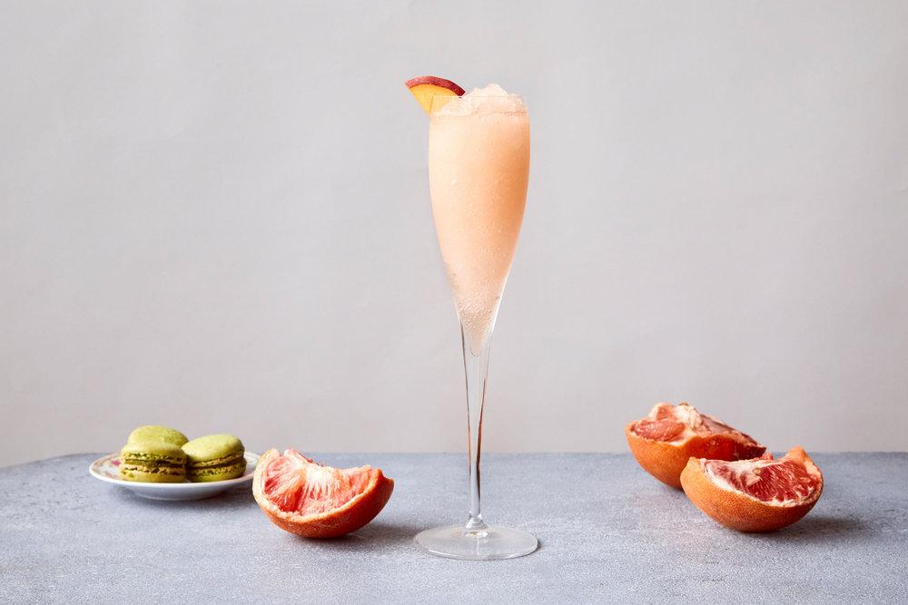 bellini - Kelvin Citrus Slush Mix,Prosecco, Rum, Peach Liqueur