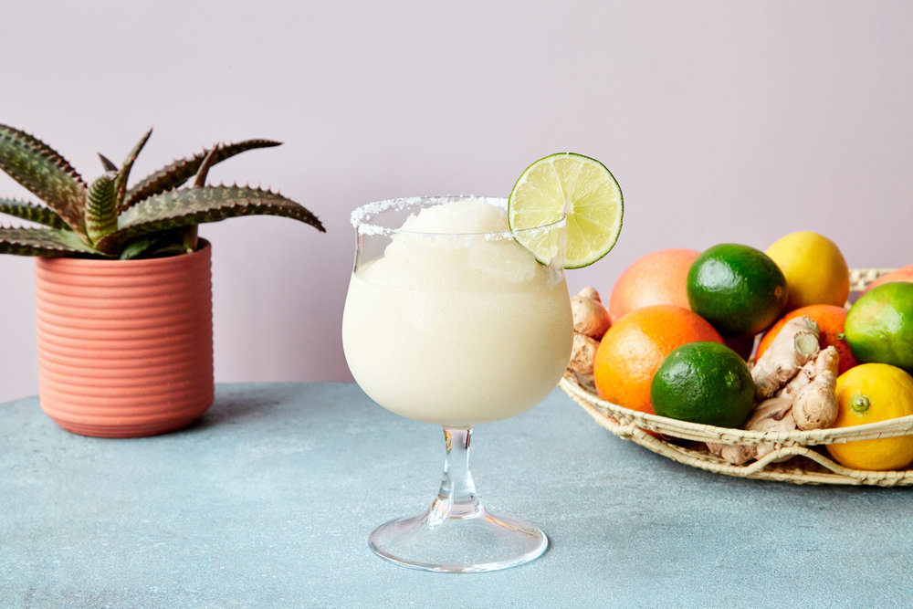 Ginger margarita with a fresh lime in it.