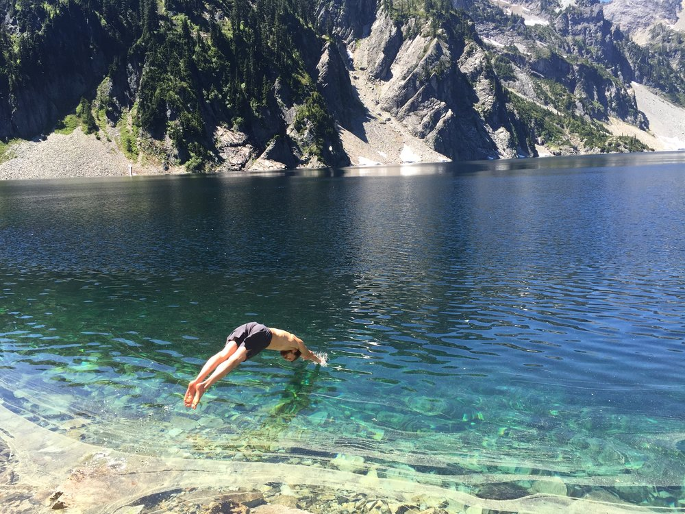 Diving in the water at Snow Lake. Hike in WA, PNW