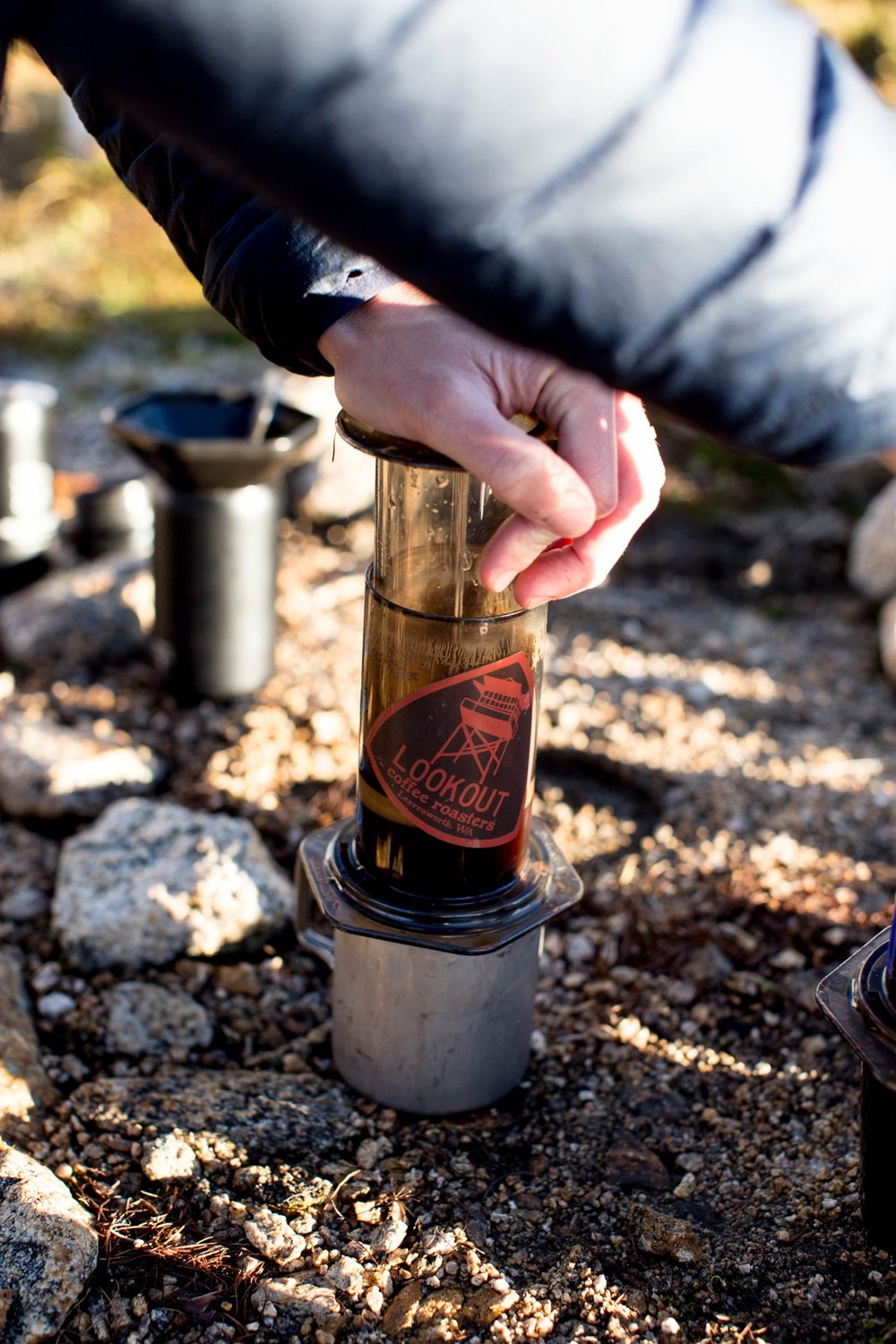 An Aeropress is an easy and portable device to use while backpacking and camping.