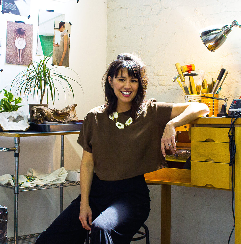 Jewelry Artist, Founder_ - Kim Devall trained as a jewelry designer and metalsmith at the Fashion Institute Technology in NYC, but she truly developed as an artist when she discovered the world of 'alternative materials'. She aims to create wearable sculpture by exploring a broad range of materials such as wood, bone, cement, rubber, lucite and elevating each piece with fine metalwork.