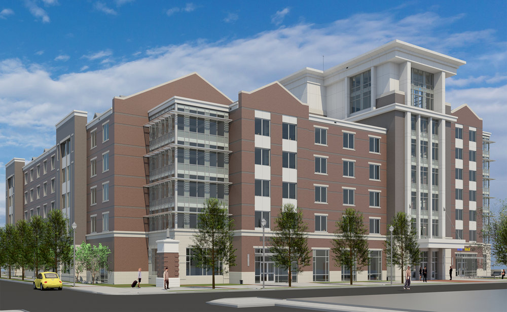 UTC West Campus Housing   The West Campus Housing at UTC will house 600 students and provides 680 new parking spaces.  A new tennis center and maintenance building is included with the project.  The 209,500 sf building was designed to visually bridge the architecture of the campus and that of the new developments on Vine Street and the surrounding downtown.