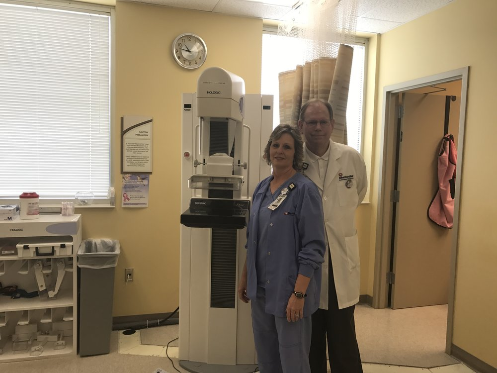 Methodist North Mammographer, Donna Morris, and Director of Radiology Services, Gary Britt, stand in front of their mammography machine.