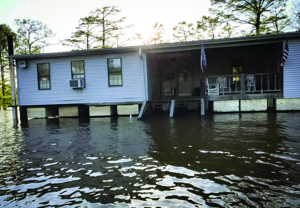 The building actually floats when it is in flood stage.  But don't worry, you can still eat there - you just have to use a boat!