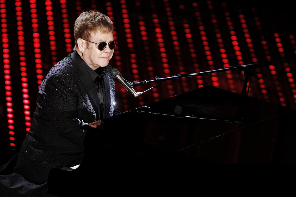 For his charitable work, Elton John was knighted by Queen Elizabeth II on February 24th 1998.