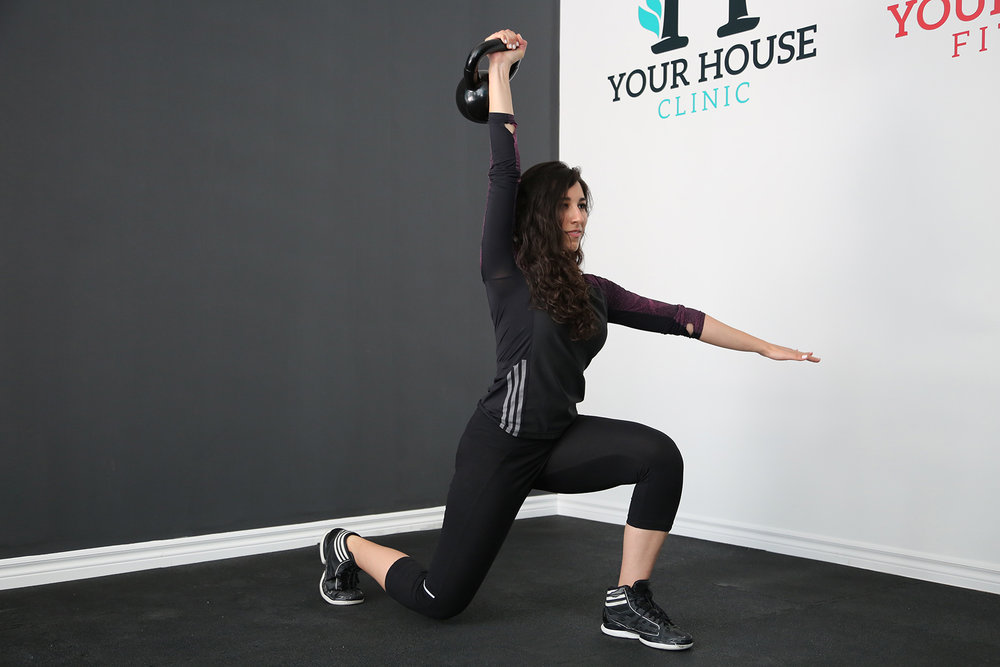 Sara performing a lunge with a press