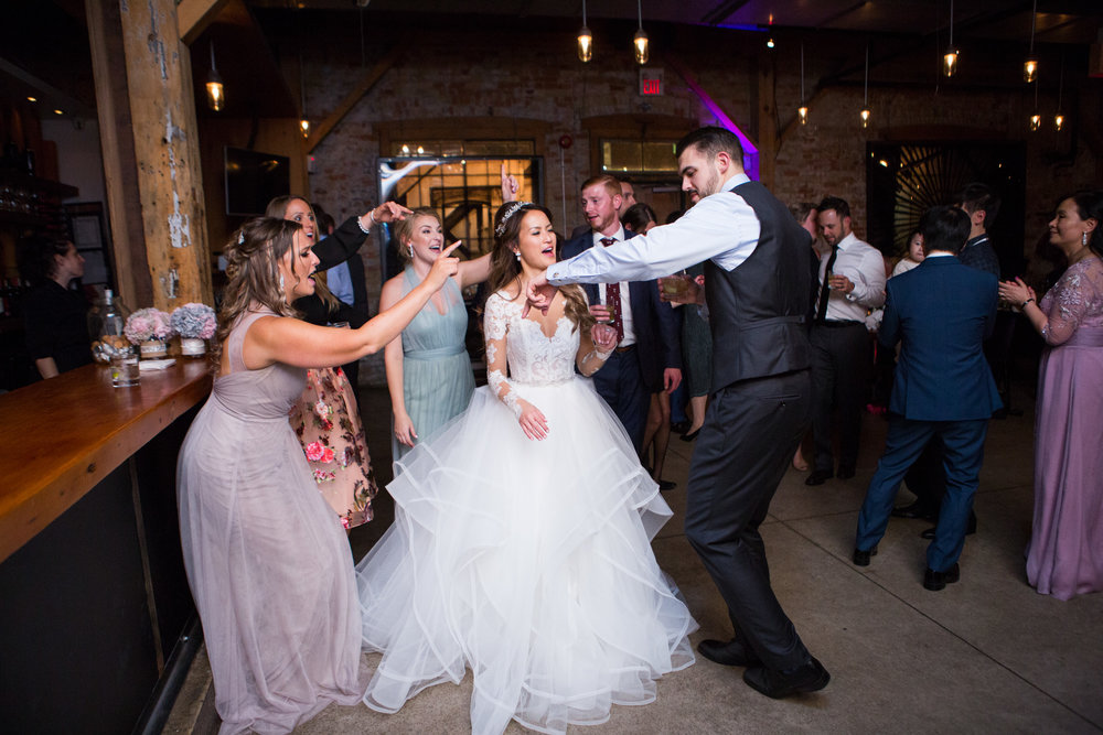 Wedding guests dancing at Archeo Distillery District Toronto