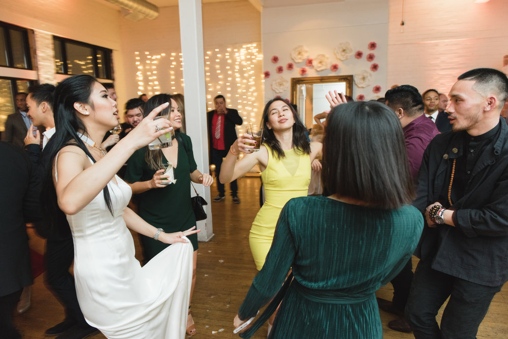Wedding guests dancing at Burroughes Building Toronto