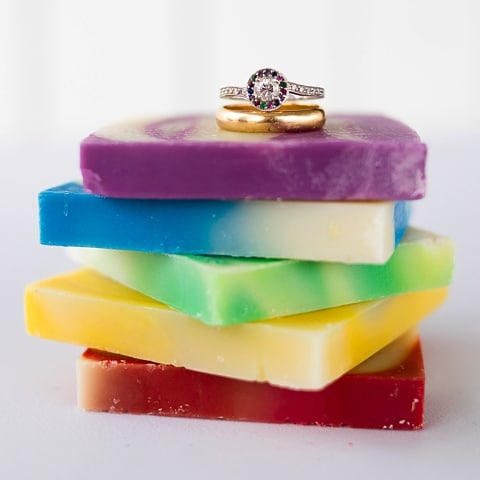 Happy (late) Thanksgiving and (early) Small Business Saturday from RainbowSudsSoap.com! ❤️🧡💛💚💙💜 We thought we'd share a favorite pic from our wedding in August, taken by @merryohler!! It shows off both our special soap recipe and our family/custom wedding rings. Sam's is his grandpa's wedding ring from 1954, and Rashaun's is Sam's grandma's diamond set in a custom rainbow ring by @lauriesarahdesigns.  #handmade #charity #rainbow #soap #wedding #smallbusiness #smallbusinesssaturday #allnatural #vegan #soapmaking #professionalphotography #ididnttakethis