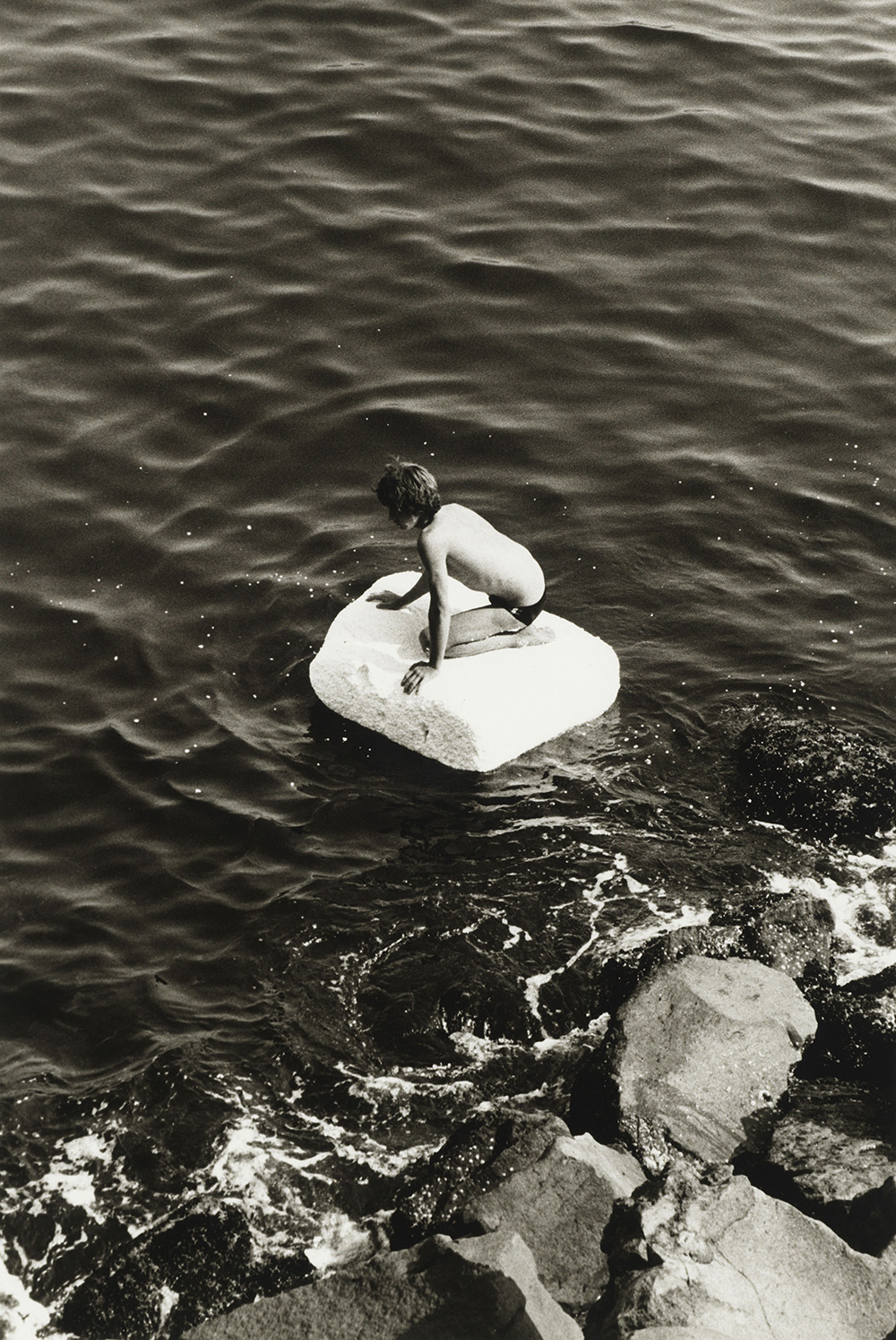 Boy On Raft (1978) © Peter Hujar Archive, LLC, courtesy Pace/MacGill Gallery, New York and Fraenkel Gallery, San Francisco