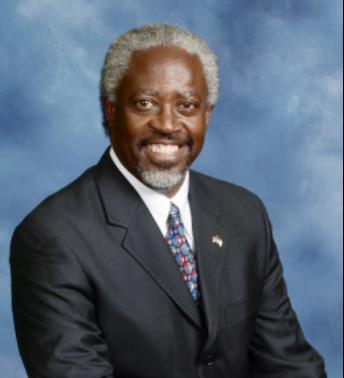 Pastor Rolland Slade