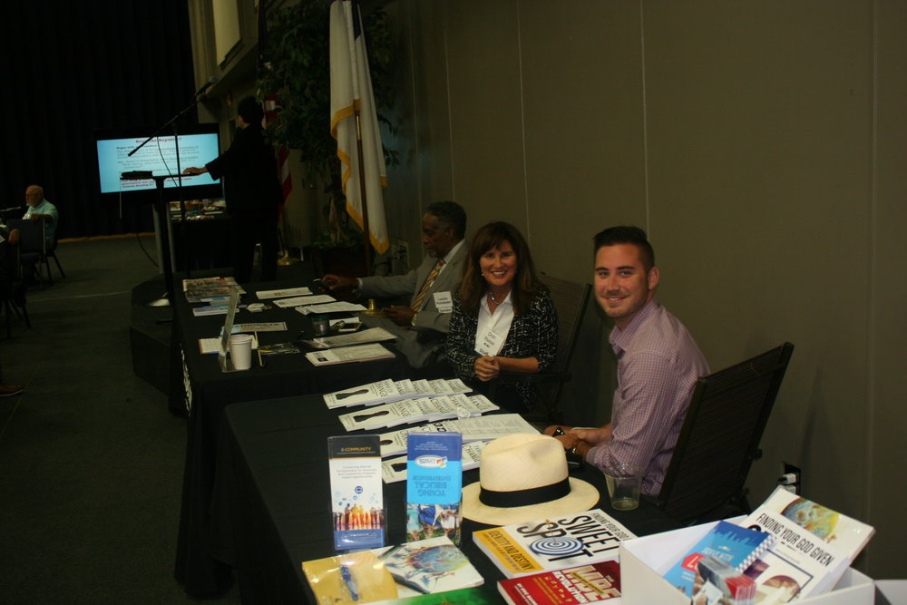 Exhibitors Tables - Lonnie, Dran, Trevyn.JPG