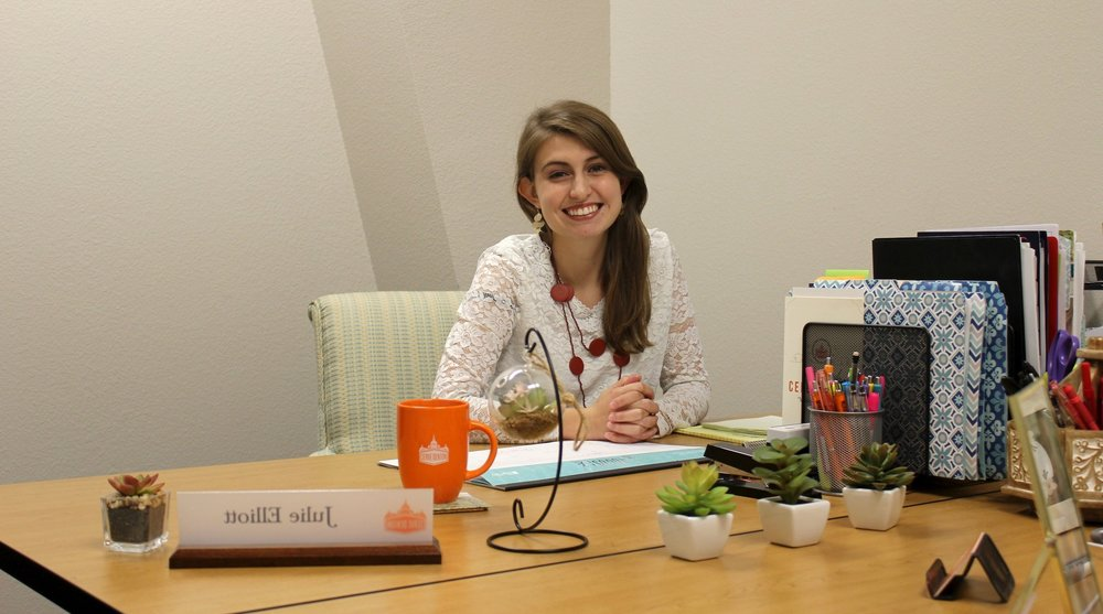 Development Coordinator Julie Elliott at her desk at the Serve Denton Center