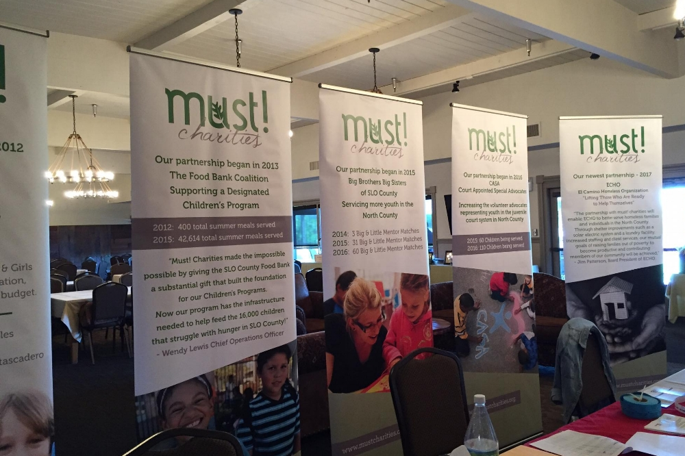 RETRACTABLE STANDS - Our friends at MUST! Charities needed a creative way to display their info. We love the way our retractable banner stands look. Whether you're looking to stand out at a trade show, or you need that extra boost in your lobby, these indoor stands are the answer.