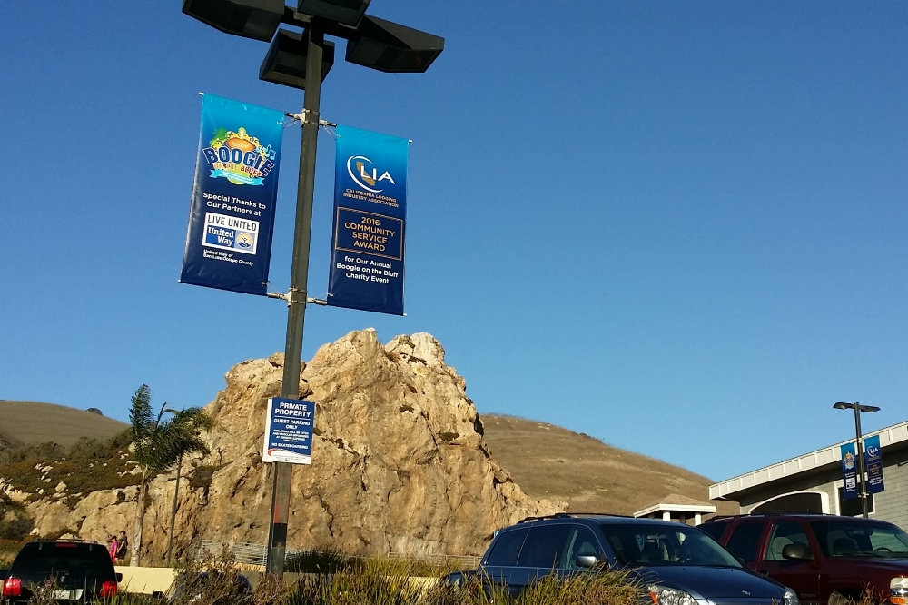 LIGHT POLE BANNERS - Light pole banners are a great way to highlight a company event or accomplishment and they're also good for sprucing up your parking lot! Several hotels and hospitals on the Central Coast have used this great idea for their lots.