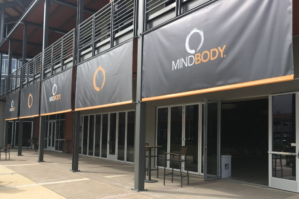MESH BANNERS - These mesh banners allow the air to flow through and at the same time, provide some shade and branding to the Mindbody courtyard. We went a step further and added pole pockets to the bottoms for extra weight.