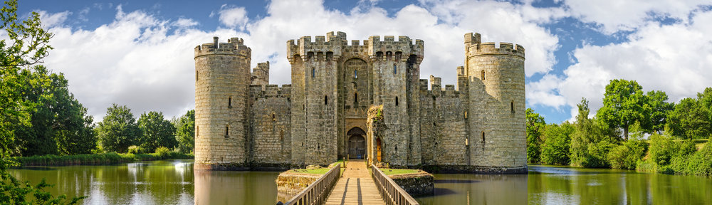 Moated castle Bodiam near Robertsbridge in East Sussex, England was built in 1385 to defend the area against French invasion during the Hundred Years' War.