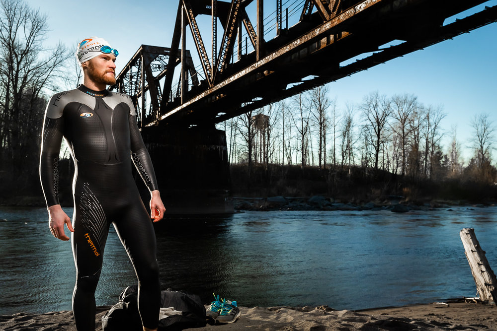 Eric Lagerstrom poses for a portrait showing off his Blue Seventy Thermal Wetsuit after Swimming the Sandy River just out side of Portland, Oregon in the middle of January.