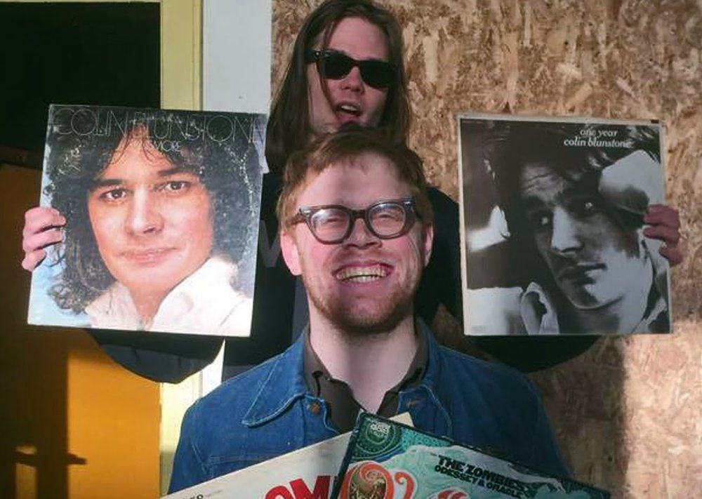 Amos Pitsch with Tenement bassist Jesse Ponkamo and some favorite Zombies-related LPs. Photo by Black Thumb.