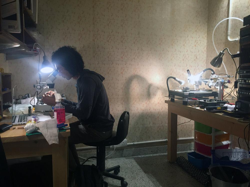 Malhotra uses a microscope to inspect a newly cut record. Photo by Ashutosh Sharma.