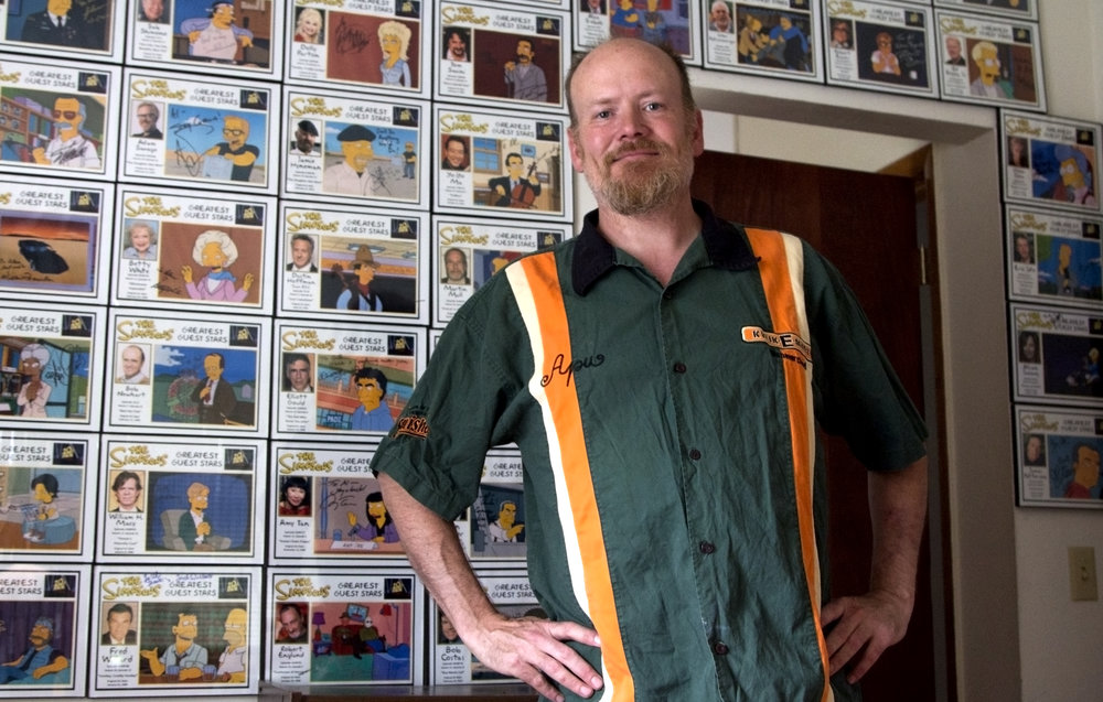 "Al Hart at home with the autographs he's collected from ""Simpsons"" guest stars so far. Photo by Alan Talaga."
