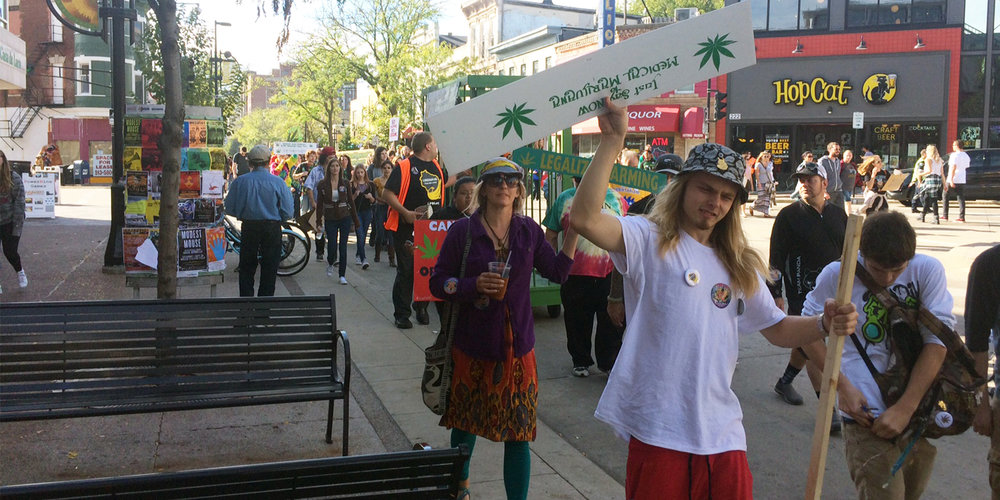 Participants in the 2017 Great Midwest Marijuana Harvest Festival march down State Street. Photo by Reid Kurkerewicz.