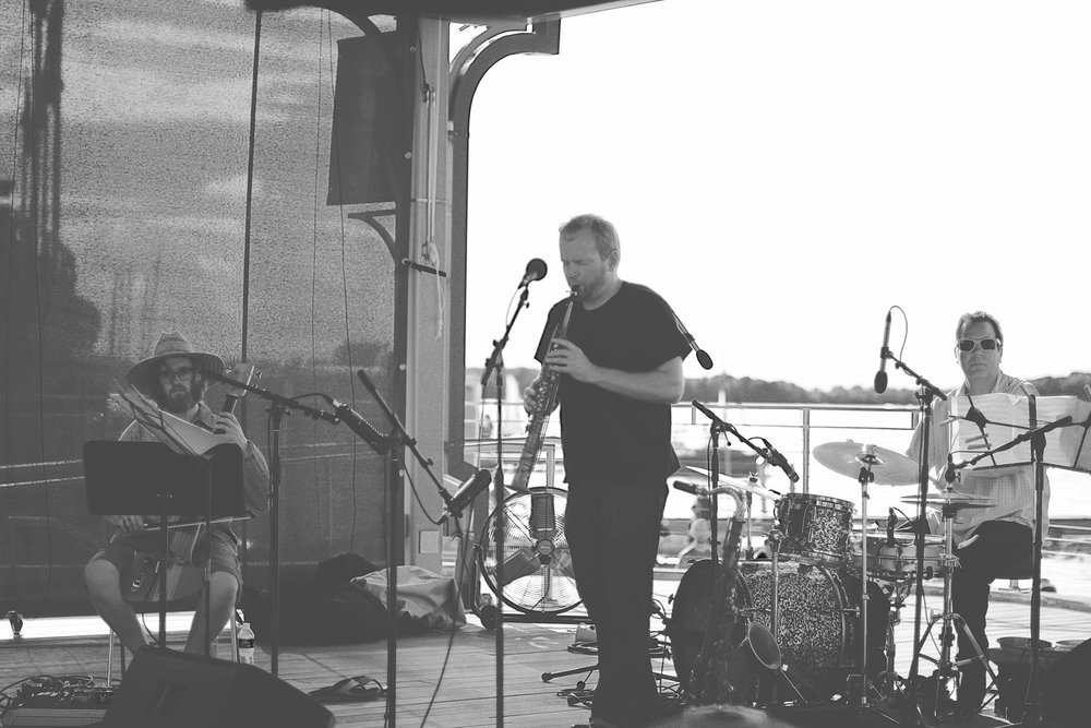 Stray Passage are, from left to right: Brian Grimm, Brennan Connors, and Geoff Brady.