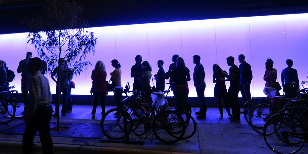 Patrons waiting outside the Central Library for a Night Light event hosted by the Library's Bubbler project. Photo via  madisonbubbler.org