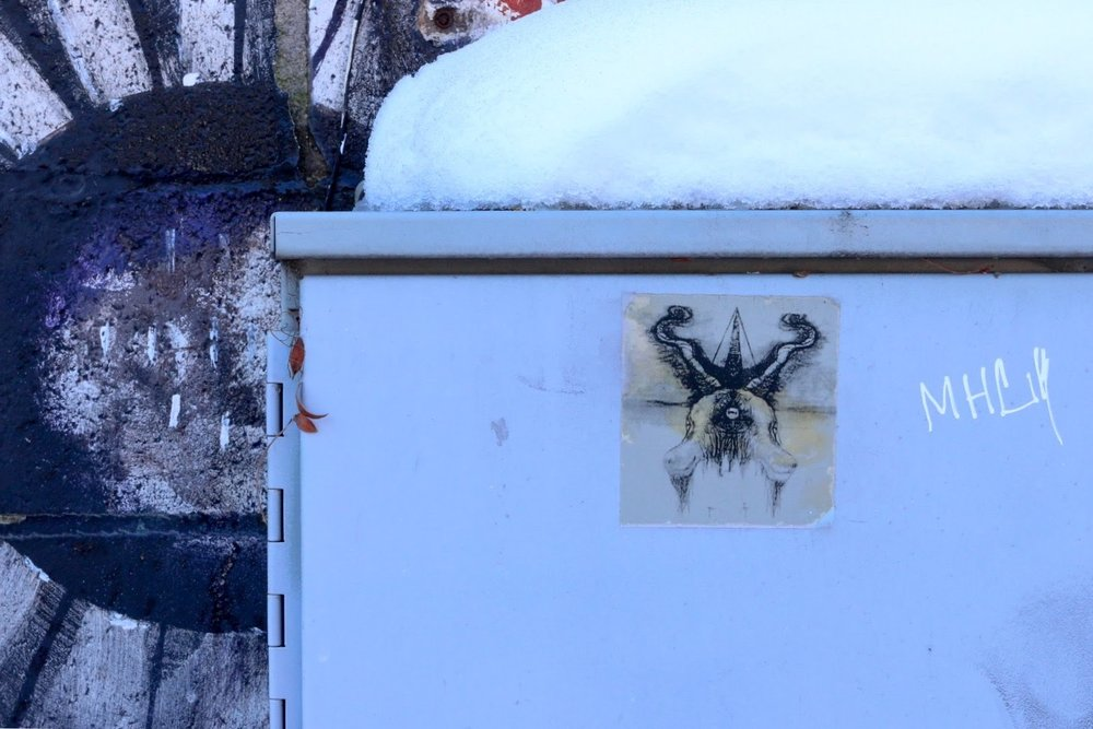 Sticker and graffiti on a utility box near the WORT-FM studio downtown.