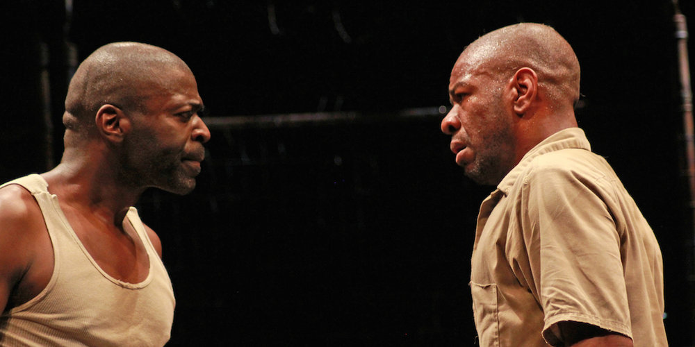 "Chiké Johnson (left) and La Shawn Banks in ""The Island."" Photo by Carissa Dixon/courtesy of American Players Theatre."