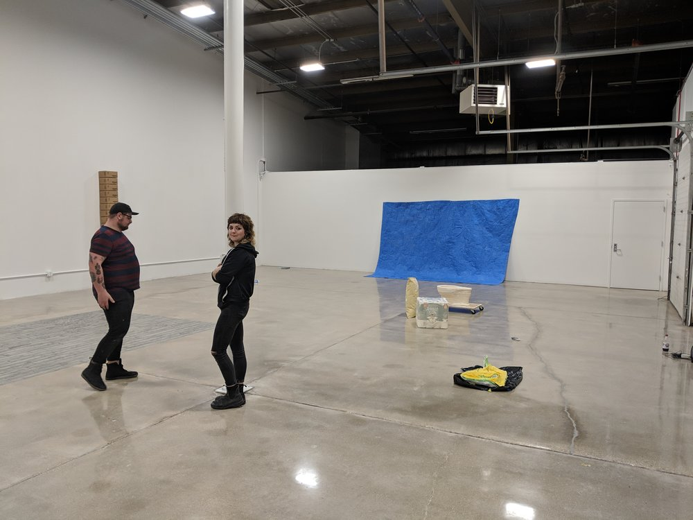 Klemens and fellow third year Sculpture MFA Eric Ford installing Klemens' show at Backspace. Photo by Abrahm Guthrie.